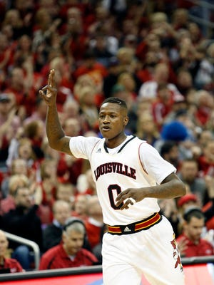 Louisville's Terry Rozier signals he just made a three. 