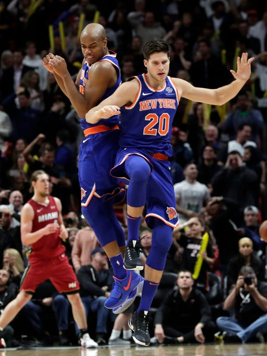 New York Knicks' Doug McDermott (20) celebrates with teammate Jarrett Jack after hitting a three-point basket to force overtime during an NBA basketball game, Friday, Jan. 5, 2018, in Miami. (AP Photo/Lynne Sladky)