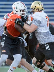 Miami defensive end Thomas Chad (90) and Army offensive tackle Brett Toth (78) lock up during practice for the Senior Bowl in Mobile, Alabama on Tuesday, January 23, 2018.
