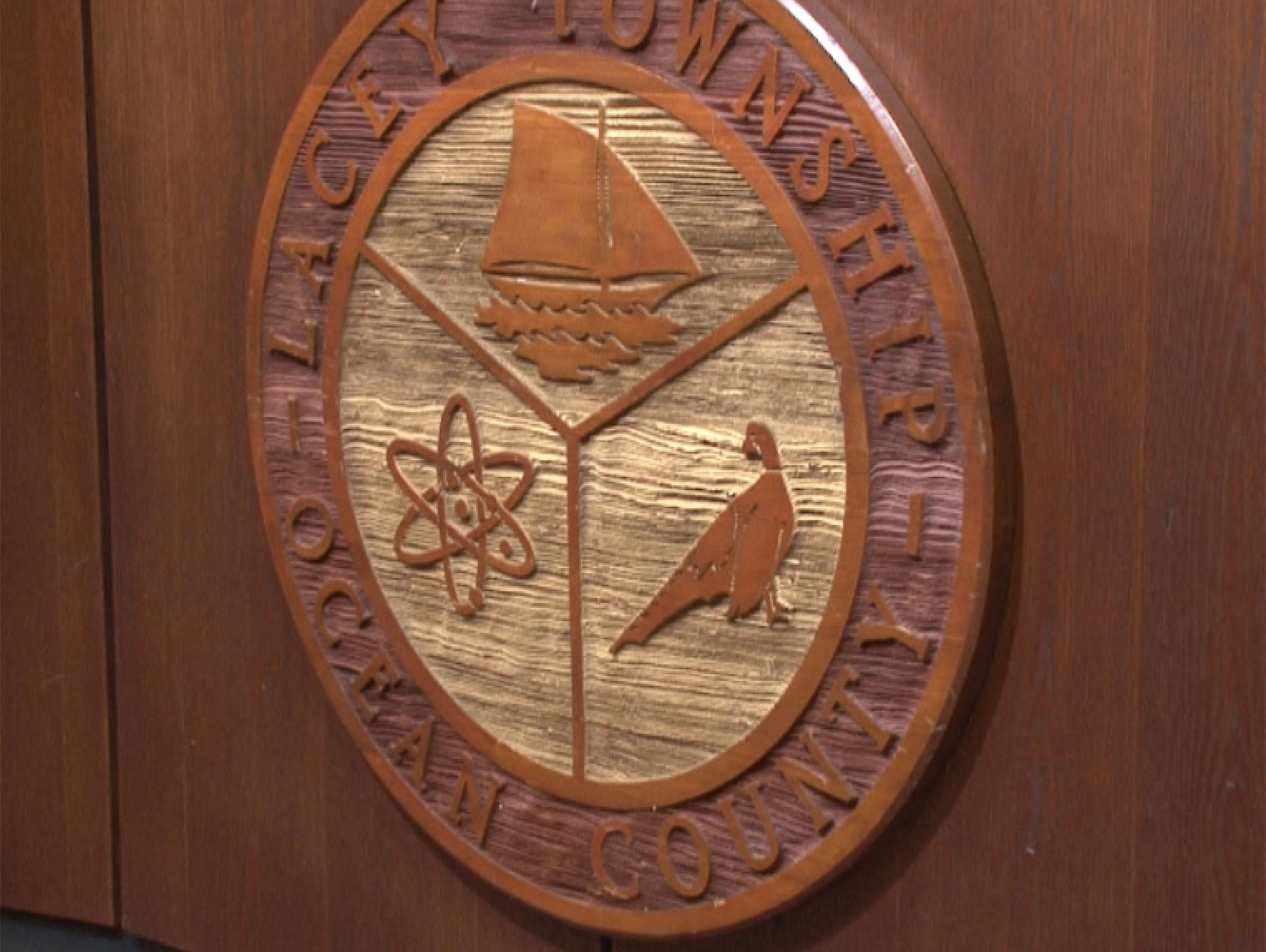 The Lacey Township seal in the meeting room in Town
