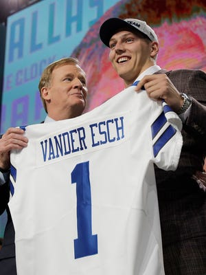 Commissioner Roger Goodell, left, presents Boise State's Leighton Vander Esch with his Dallas Cowboys team jersey during the first round of the NFL football draft, Thursday, April 26, 2018, in Arlington, Texas.