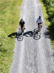 A pair of cyclists ride their bikes on the Lebanon Valley Rail Trail west toward Mount Gretna on Friday, Sept. 2, 2016. Tropical Storm Hermine is expected to bring cloudy skies and strong winds to the Lebanon Valley on Sunday.