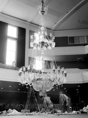 March 18, 1952 - A 1,400-pound mass of cut crystal inched its way ceiling-ward on March 18, 1952, as Bellevue Baptist Church continued preparations for moving into its $1,200,000 sanctuary on April 27. The 24-foot-long chandelier — one of the 12 largest in the nation — contains 9,000 cut crystal pieces. The new building is just north of the church at 40 North Bellevue.