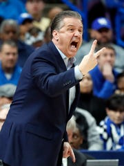 Kentucky head coach John Calipari yells to his players during the first half of an NCAA college basketball championship game against Tennessee at the Southeastern Conference tournament Sunday, March 11, 2018, in St. Louis. (AP Photo/Jeff Roberson)