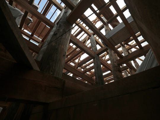Wooden beams are used in the construction of a replica
