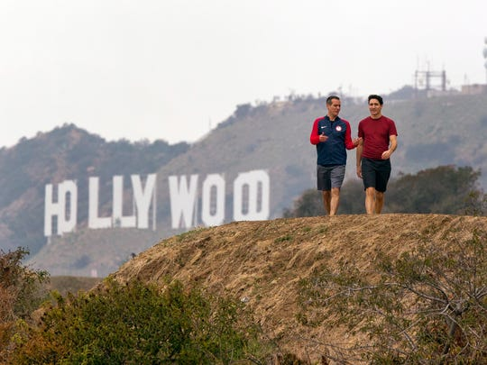 Los Angeles Mayor Eric Garcetti, left and Canadian Prime Minister Justin Trudeau take a hike in the Hollywood hills after a news conference at the Griffith Observatory, Saturday, Feb. 10, 2018 in Los Angeles.