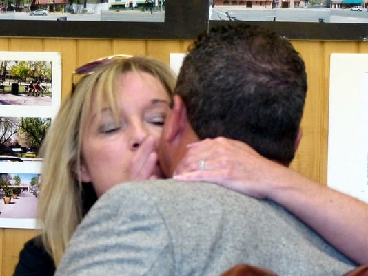 sara proctor hugs wade before the hearing