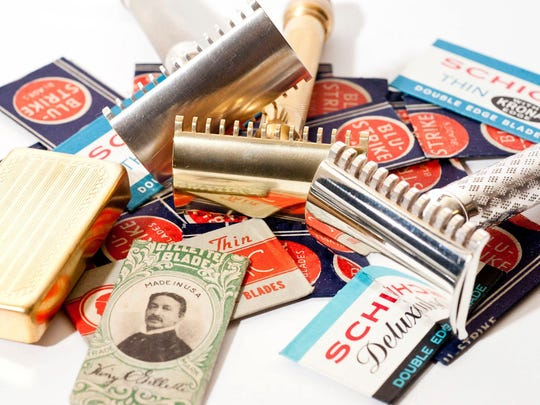 A collection of vintage safety razors and vintage double edge blades