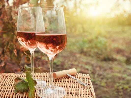 Two glasses of the rose wine in autumn vineyard