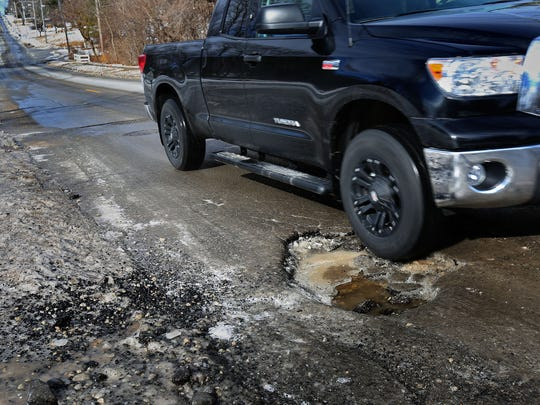 A pothole on Park Avenue near SW 32nd Place pictured on Saturday, Feb. 22, 2014.
