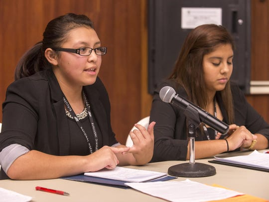 The attorney team of Thelma Manzano, left, and Melissa Meina deliver their arguments in mock court at the University of Rochester Friday.