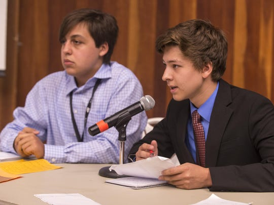The attorney team of Branndon Baez, left, and Daniel King deliver their arguments in mock court Friday at the 2015 New York Lorenzo De Zavala Legislative Session at the University of Rochester.