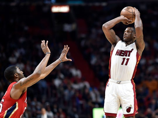 Mar 15, 2017; Miami, FL, USA; Miami Heat guard Dion Waiters (11) shoots over New Orleans Pelicans guard Wayne Selden Jr. (25) during the second half at American Airlines Arena. Mandatory Credit: Steve Mitchell-USA TODAY Sports