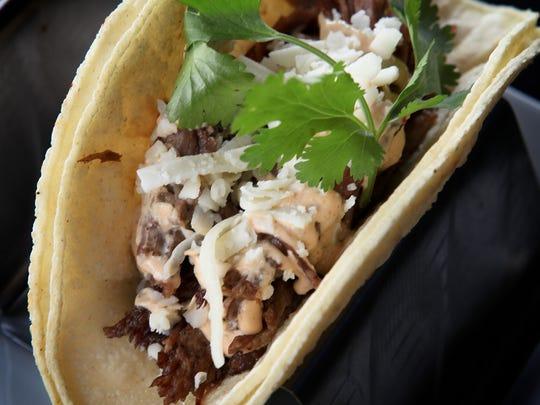Costillitas - Adobo spice-rubbed short rib topped with chipotle crema, cilantro and queso fresco. March 21, 2014