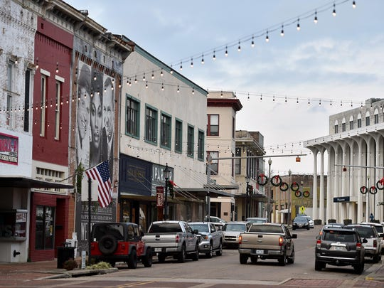 "In this 2017 file photo, once covered by an olive green canopy nicknamed ""the shed,"" downtown Laurel is now adorned with string lights once more. Lee's Coffee and Tea is a popular breakfast and lunch spot downtown."