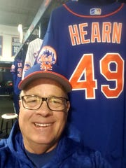 Ed Hearn with his jersey in Port St. Lucie at a recent camp.
