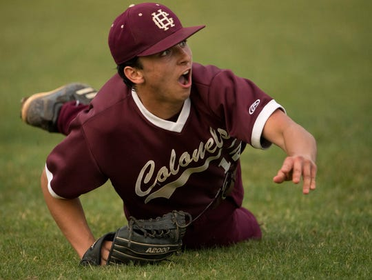 Henderson County's Bryce Willett makes a throw to first