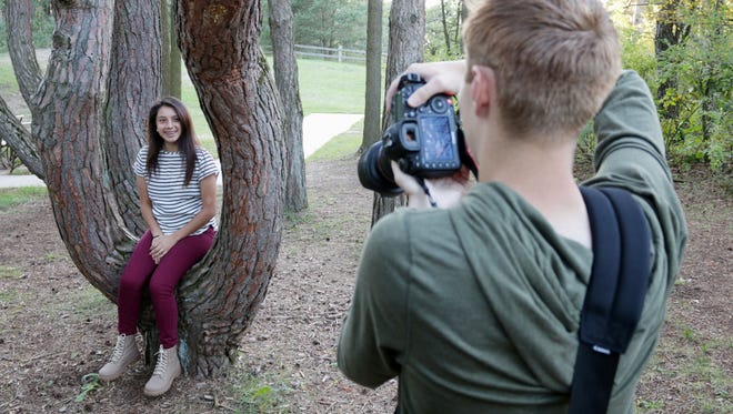 Sam Melendez, 17, left, poses for Zach Schramm, 18, during a practice senior portrait session Friday, Sept. 11, at Kohler-Andrae State Park in Sheboygan.