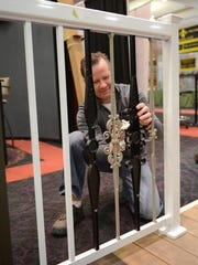 Pete Krabbe of Seymour Lumber sets up a railing system display Tuesday at the KI Convention Center in downtown Green Bay in preparation for the Brown County Home Builders Association 2015 Home Expo. The annual event runs Thursday through Saturday.