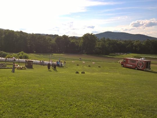 The Farmers & Chefs truck is shown parked onsite at Fishkill Farms for a farm-to-table dinner.