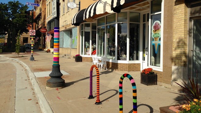 Lemon Loves Lime co-owner Joy Cha was the creative force behind downtown Menasha's yarn project.