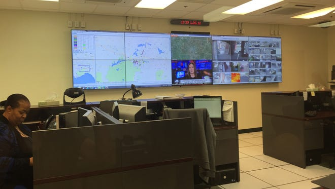 At the district's security and safety center, large screen televisions show surveillance of all campuses.