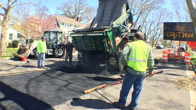 City and county workers temporarily fix Fourth Avenue, which has become a main thoroughfare in town since the Sunset Avenue Bridge closed for reconstruction in January 2015.