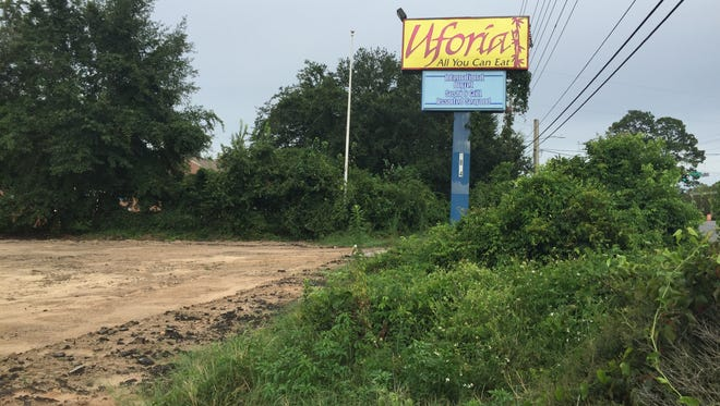 A lone Uforia sign sits on the empty lot that will soon house a new hotel.