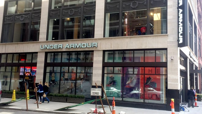 Workers put final touches on the Under Armour store on Tuesday, April 11, 2017,  at 1201 Woodward in Detroit that is set to open Thursday.