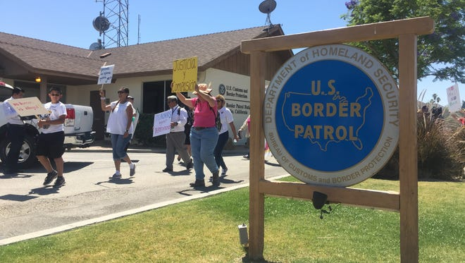 Nearly 100 demonstrators spoke out against immigration enforcement policies that detain immigrants who don't have a criminal record and separate families. This protest happened outside the Border Patrol's Indio station on Monday May 1, 2017.