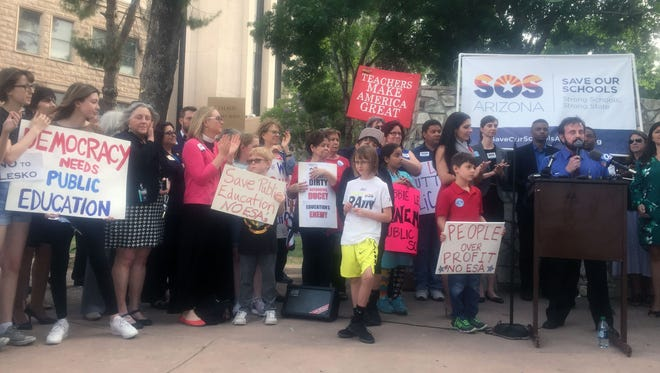 Public education advocates hold a rally at the Arizona State Capitol on May 8, 2017, to protest the state's expansion of its school voucher program.