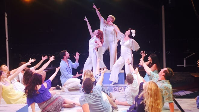 """The cast of """"Mamma Mia!"""" playing at Chaffin's Barn through Oct. 21."""