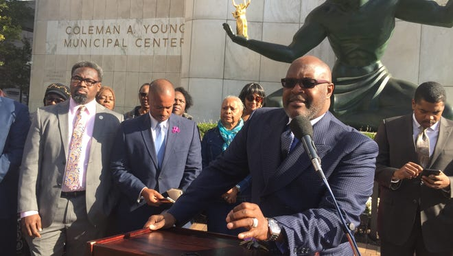 Standing in front of the Spirit of Detroit statue on Oct. 19, 2017, gospel music star the Rev. Marvin Winans advises voters to defeat two proposals on Detroit's November ballot; both aim to ease restrictions medical-marijuana outlets in the city. Behind him, left to right, are Detroit City Councilmen James Tate and Scott Benson.