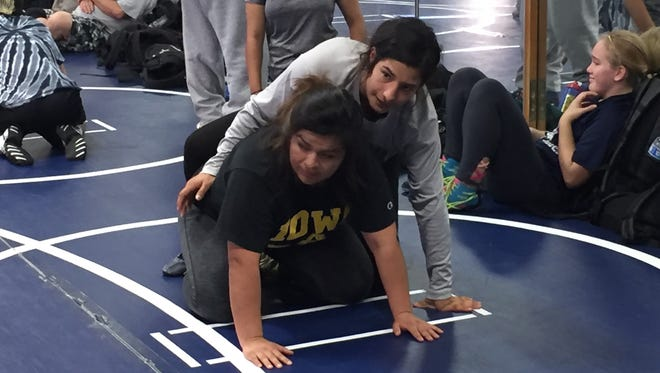 Camarillo High senior wrestler Yazmin Gonzalez, above, is making her second straight appearance at the CIF State Girls Wrestling Finals.