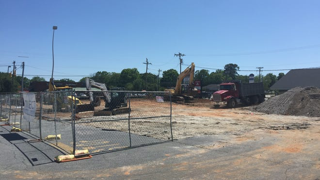 A construction team works at the site of a new Verizon store planned on West Butler Road in Mauldin on Monday, April 30, 2018.