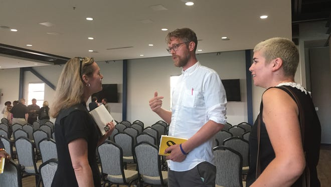 Mary Culler, from Ford's Detroit Development Team, introduces herself to Jerry Paffendorf and Heather McKeon who were elected Monday, July 30, 2018, to a Corktown Neighborhood Advisory Council.