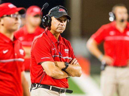North Greenville head coach Jeff Farrington watches his defense on a goal line stand against Newberry on Saturday, September 17, 2016 and North Greenville University.