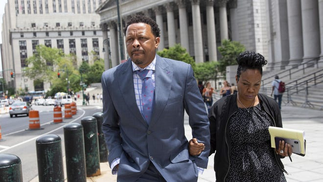 Former Oklahoma State assistant basketball coach Lamont Evans leaves the courthouse in New York after his sentencing in federal court on June 7, 2019.