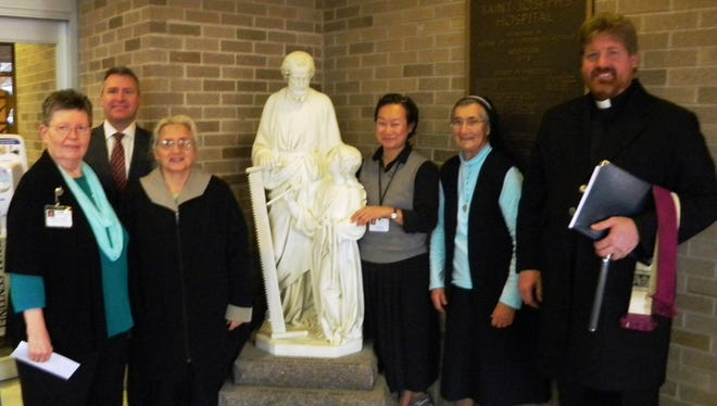 Pictured are Sister Lois Bush, senior adviser to the president and chief executive officer of Ministry Health Care and representative of the Sisters of the Sorrowful Mother Leadership Team; Brian Kief, president Ministry Saint Joseph's Hospital; Sister Rita Adlkofer; Sister Mary Shin; Sister Barbara Hollweck; and Father Eric Berns from Our Lady of Peace Catholic Church in Marshfield.