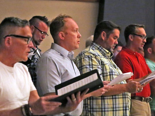 The Indianapolis Men's Choir sings during a vigil, Sunday, June 12, 2016, at the Old National Centre's Egyptian Room, in Indianapolis to remember those who died and were injured in the Orlando mass shooting at the Pulse, a gay nightclub just south of downtown Orlando.  The vigil was organized by Indy Pride.(Kelly Wilkinson/The Indianapolis Star via AP)