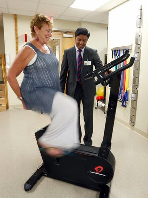Orthopedic surgeon, Dr. Arup Bhadra, right, works with total knee replacement patient Florence Hannes at Good Samaritan Hospital in Suffern on Wednesday, August 31, 2016.