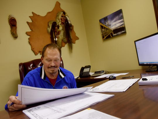 Greg Branaugh works at his business, D&G Concrete Construction