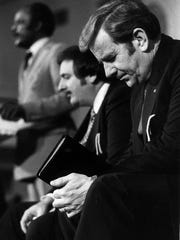 The Rev. Jerry Falwell, right, prayed during a meeting of the Moral Majority at Ninth & O Baptist Church during a visit to Louisville on March 26, 1981.
