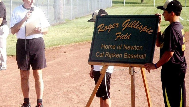Roger Gillispie, left, saw a baseball field named in his honor in 2014. This year he enters the Newton High School Athletic Hall of Fame. He died of cancer in April.