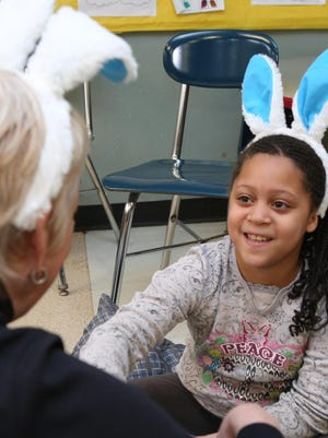 "Donna Reilly talks with Destiny Lewis before a autism-friendly performance of ""Bookmarks"" by Yellow Finch Project at the Westchester Exceptional Children's School in North Salem in April. Reilly played the autoharp for ""Bookmarks,"" teaching the audience songs to accompany ""Treasure Island,"" ""The Tale of Peter Rabbit"" and ""The Call of the Wild."""