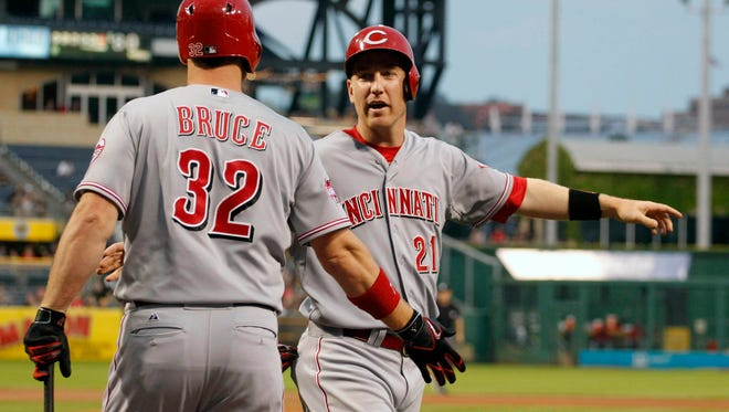 Reds right fielder Jay Bruce (32) greets third baseman Todd Frazier after Frazier scored a run against the Pittsburgh Pirates during the fourth inning Wednesday at PNC Park.