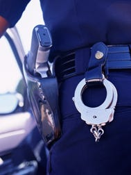 A file photo of a police officer's handcuffs. Sparks police are searching for a man who may have been involved in a attempted kidnapping Monday afternoon.