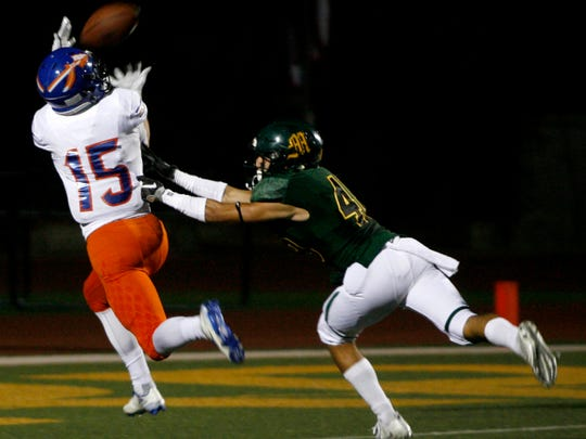 Westlake High receiver Michael Carner (left) catches a pass for a touchdown over Moorpark High's Joaquin Sandoval during Friday's game.
