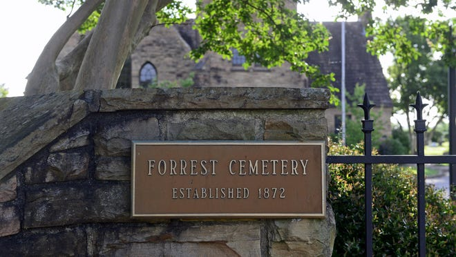 A sign at the entrance to Forrest Cemetery in Gadsden is pictured.