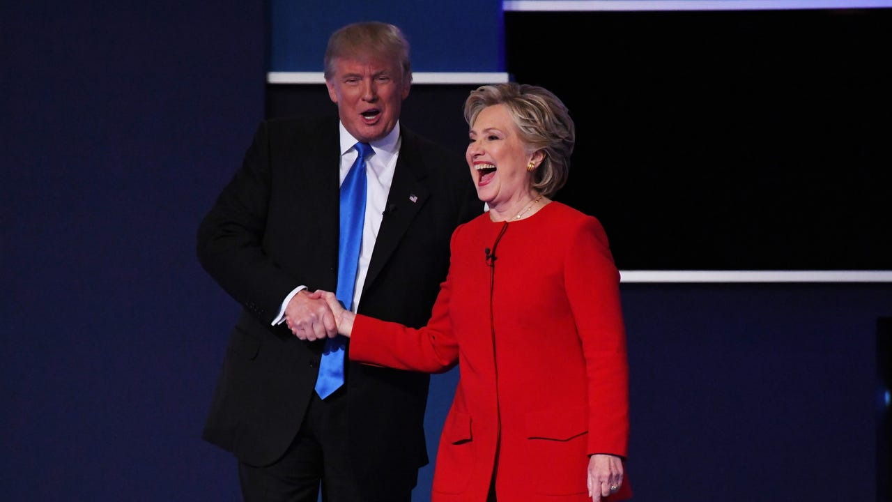 Hillary Clinton and Donald Trump greet each other on